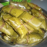 Chikwangue cassava paste roll cooked inside a leaf wrap